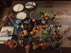 A huge lot of skylanders with consoles. AVAILABLE