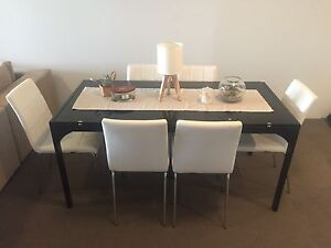 Dining table and chairs. Glass top. West End Brisbane South West Preview