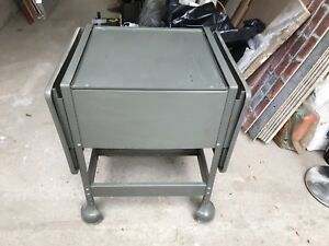 Industrial medical rolling table. Steel. Gray.