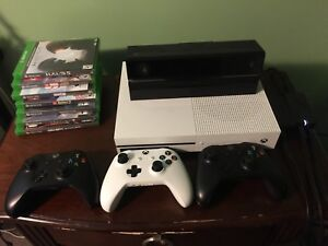 Xbox one a with 3 controllers and Kinect with 7 games