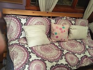 Solid Pine Futon with multiple covers . Excellent condition