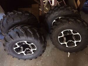 2013 can am outlander stocktires and rims.