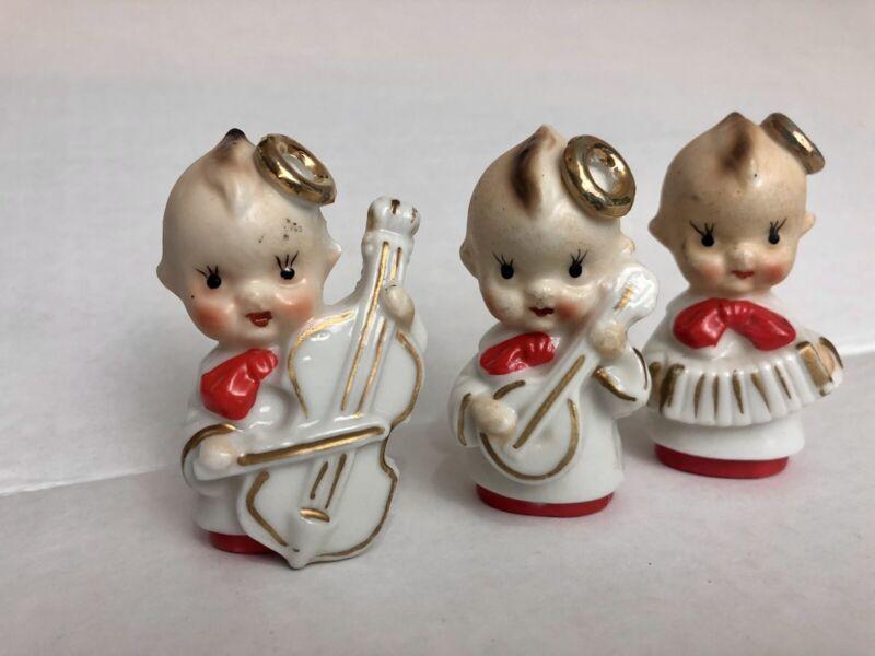 Vintage Ceramic Christmas Kewpie figurine Halo Japan banjo cello accordion