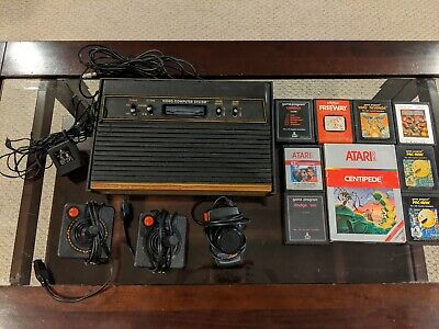 Atari 2600 Launch Edition Woodgrain Console with 3 Controllers and 8 Games!