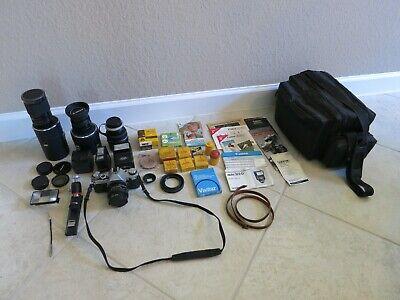 Canon AE-1 Program with 3 Lenses, 2 Flash Units, Tele Converter, Bag, Manuals