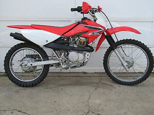 CRF 100F 4 STROKE DIRT BIKE, WELL MAINTAINED, RUNS GREAT!!