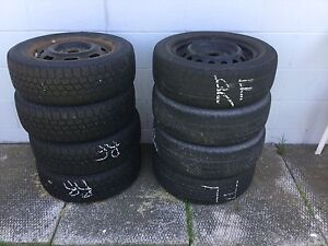 2 sets of steel rims with low tread tire