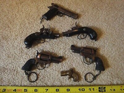 Vintage diecast cap gun keychain lot. 45 army colt, Pirate, revolver handgun.