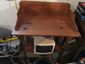 Old rocking chair,plant type table and dry sink.