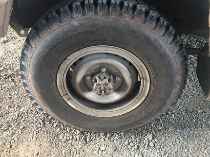 Wanted: 4 Toyota landcruiser split rims and tyres