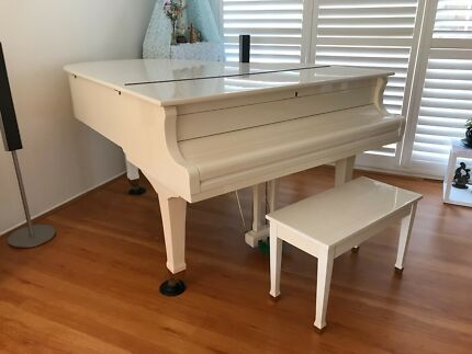 Beautiful white Wurlitzer grand piano