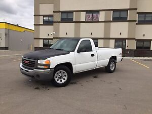 2006 GMC 1500 reg cab long box 4X4.