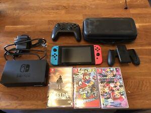 Nintendo Switch + 4 jeux + Manette Pro + Accessoires a vendre