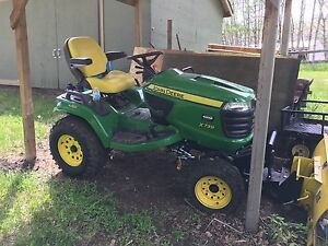 John Deere yard tractor with snow blower and blade