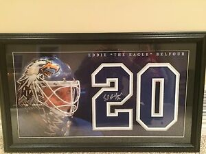 Framed autographed Ed Belfour Maple Leafs number and photo