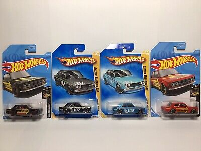 Hot Wheels '71 DATSUN 510 Momo Red And Black, W/2009 New Model Blue And Black.