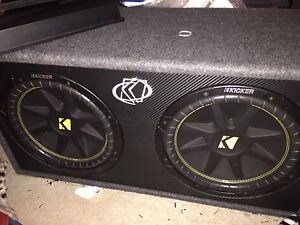 Dual 1000 watts kicker subwoofers  and amp