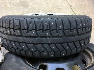 195/65R15 winter studded tires with rims and hubcaps