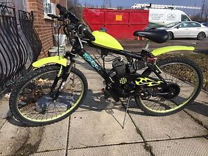 EXCITING TWO STROKE MOTORIZED MOUNTAIN BIKE BIG MPG