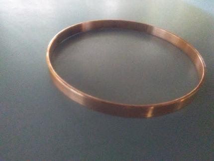 Antique rose gold bangle