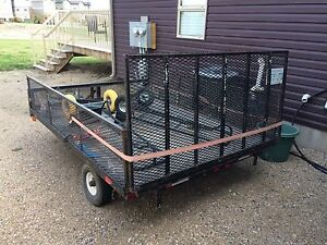 Utility trailer for sale. Ramp folds down and deck tilts
