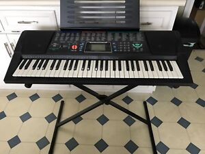 Keyboard with stand ,instruction and lesson books