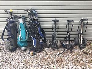 Golf clubs and push carts