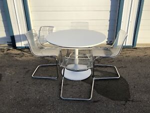 IKEA Docksta Table and 4 Tobias Clear Chairs