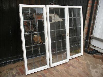 Reclaimed leaded glass windows in wooden frames