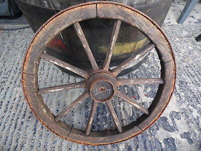 A rustic vintage small cart wheel