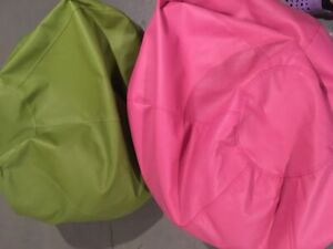 Pink and green beanbag chairs