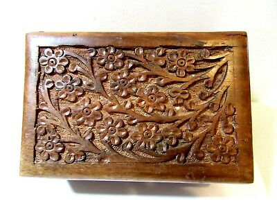 Attractive hand carved rectangular wooden trinket box from India decorated with brass floral design