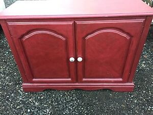 Cherry coloured red cabinet with shelves
