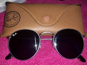 Brand new/unused original Ray.Ban glassed with recipt