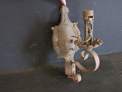 IRON SCONCE WITH DECORATIVE PLATE MARKED M.L. INC. 5860