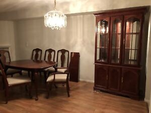 Cherry wood China cabinet and table and chairs