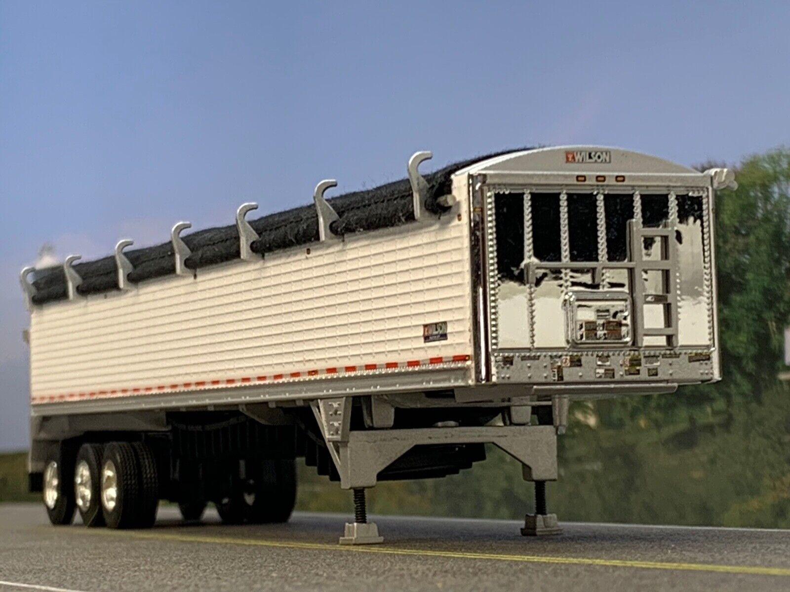 1/64 DCP WHITE WILSON PATRIOT TRI-AXLE (DUALS) BELT TRAILER W/ BLK TARP 1