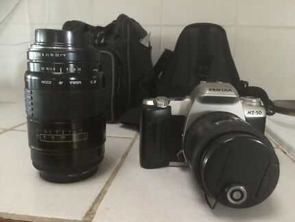 Traditional SRL Pentax camera and telephoto lens
