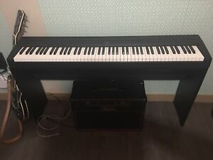 Yamaha Piano and Stand.  New Condition