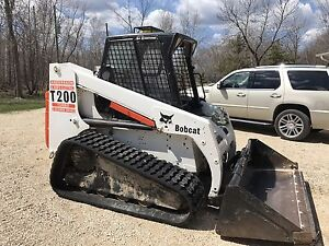 Skid steer. Bobcat. Loader. Tracks.