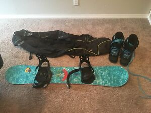 Snowboard, boots and bag