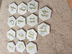 Marble with gold calligraphy event table numbers