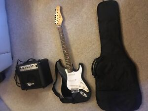 Electric Guitar with Amp,Cords and new Case