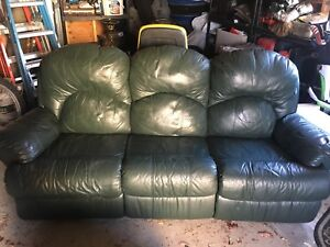 Dark green leather recliner couch and love seat
