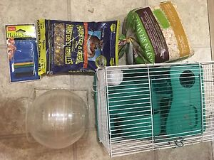 Hamster cage, ball, bedding, nibble sticks