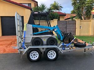 Mini Bobcat Hire $170 p/d 4n1, spreader. Delivery available