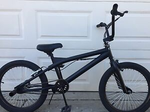 "Black Beauty BMX Bike, 20"" wheels, pegs, gyro"