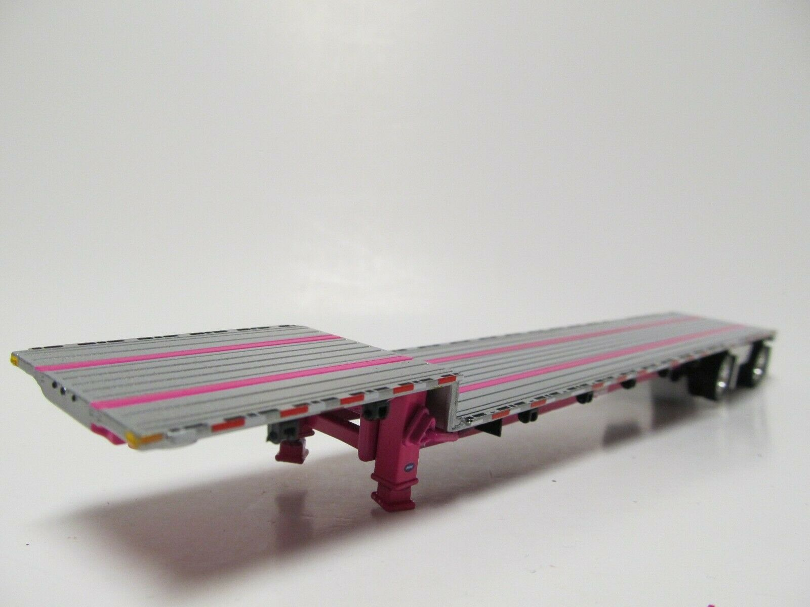 DCP 1/64 SCALE TRANSCRAFT STEP DECK TRAILER SILVER DECK WITH PINK FRAME