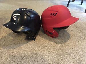 2 kids baseball helmets.