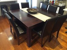 Solid teak dining table with 8 leather chairs Highett Bayside Area Preview